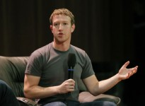 Facebook CEO Zuckerberg gestures as he addresses students at the Moscow State University in Moscow